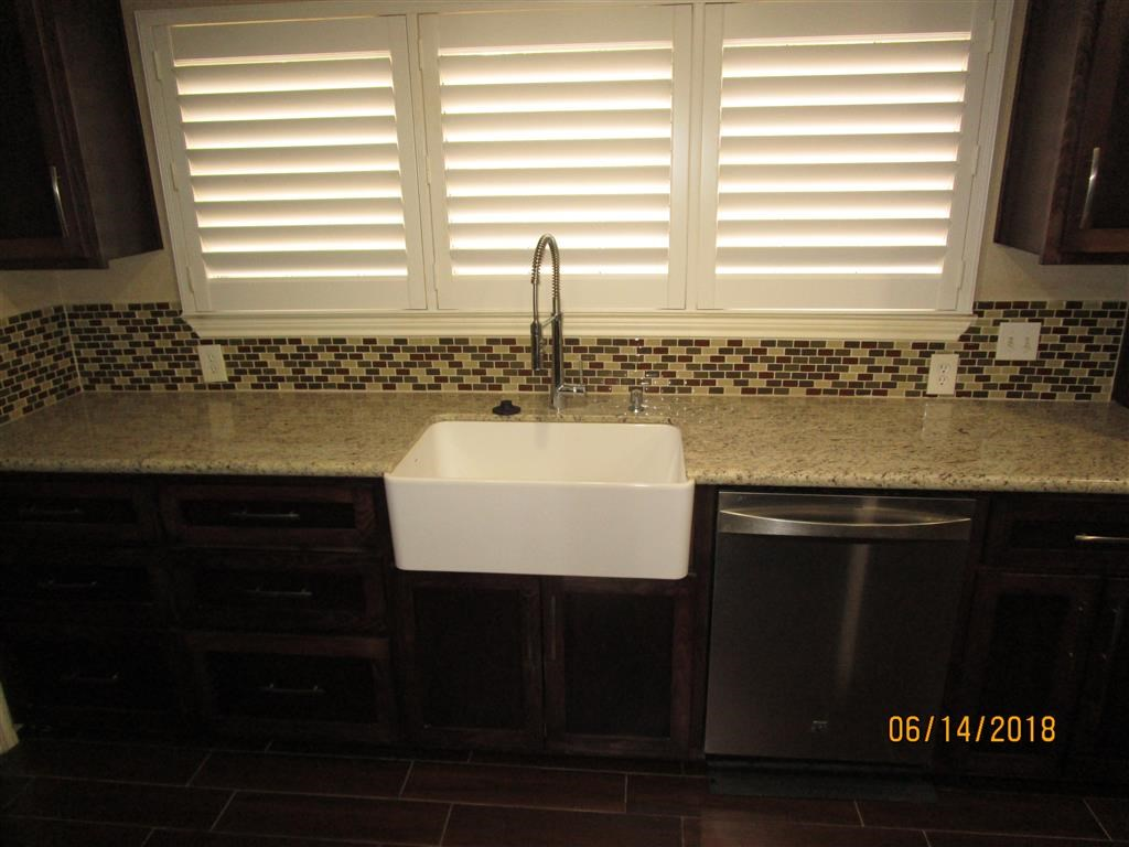 Farm sink and dishwasher.  Granite counters