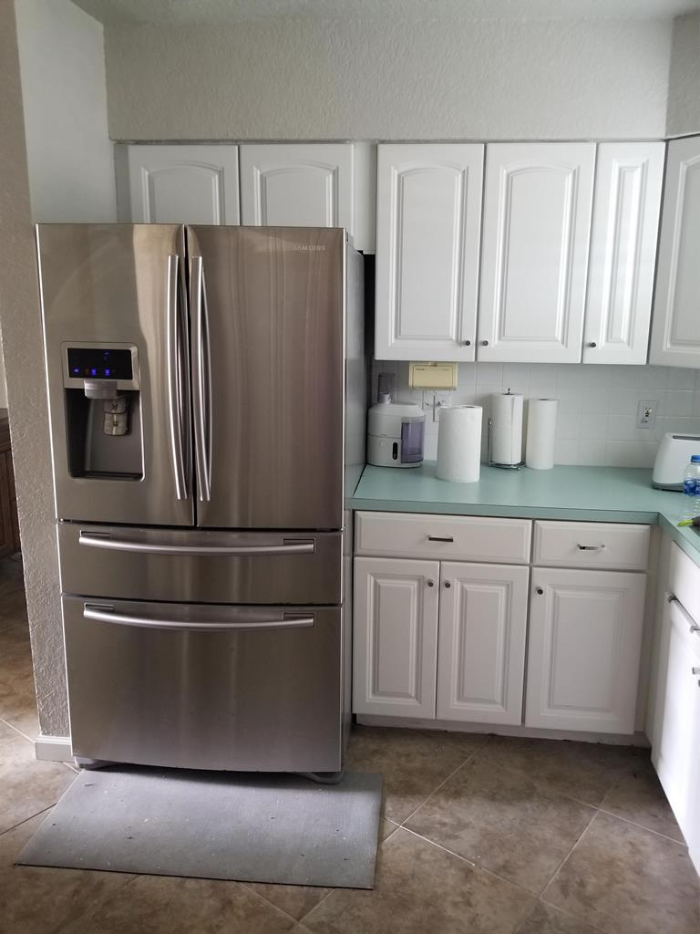 1739-Kitchen with stainless steel fridge.